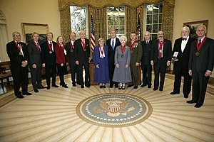 The Washington Papers - Former Editor-in-Chief Ted Crackel stands second from the right with President George W. Bush and the recipients of the 2005 National Humanities Medal
