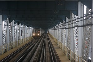Chrystie Street Connection - D train  on the north side of the Manhattan Bridge, looking toward Brooklyn