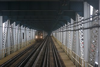 BMT Broadway Line - A D train  on the north side of the Manhattan Bridge, looking toward Brooklyn