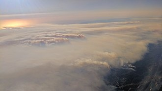 October 2017 Northern California wildfires - Aerial view of smoke from the 2017 fires in Napa and Sonoma Counties, California, on October 12 from near the south end of Lake Berryessa, nearest to the Atlas fire and looking toward the Nuns fire.  Point Reyes is visible in the distance.