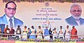 """Narendra Modi releasing a book '10 Saal, Bemisaal', on different steps taken for the development of Scheduled Casts in MP, at the launching ceremony of the """"Gram Uday se Bharat Uday"""" Abhiyan, in Mhow, Madhya Pradesh (1).jpg"""