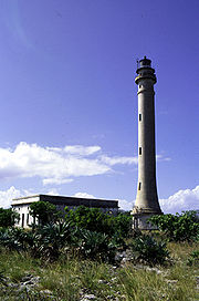 Navassa Island Light. The light keeper's quarters appear in the background.