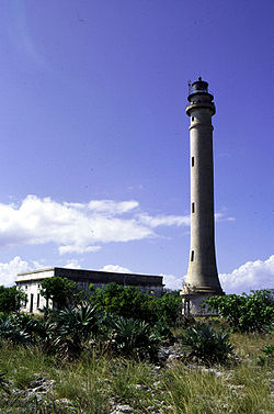 A 1999 photo of the Navassa Island Light. The lightkeepers quarters appear in the backgound.