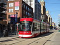 New streetcar 4404 heading south on Spadina, near King, 2014 12 20 (5) (16072650215).jpg
