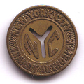 New York City subway token, now obsolete.