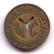 An NYCTA token from the mid-20th century