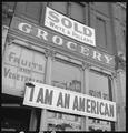 Oakland, California. Following evacuation orders, this store, at 13th and Franklin Streets, was clo . . . - NARA - 537833.tif