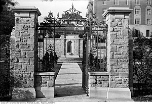Alexander Muir Memorial Gardens - Gate and monument (background) located opposite Mount Pleasant Cemetery in 1935.