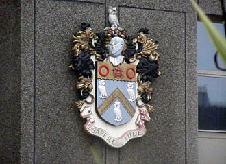County Borough of Oldham - The Coat of Arms of the Oldham County Borough Council, as found at Oldham Police Station. The station predates the merging of Oldham Borough Police into Lancashire Constabulary in 1969, and thus still displays the redundant arms.