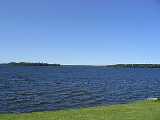 Onondaga County, New York - Oneida Lake borders Onondaga County to the northeast. It is the largest lake wholly within the state of New York. This picture was taken from the town of Cicero, a northern suburban town in the northeast part of Onondaga County.