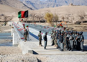 Urozgan Province - Afghan National Security Forces (ANSF) stand by near the Chutu Bridge during a grand opening ceremony for the bridge in December 2008.