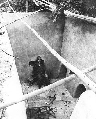 Operation Crimp - Australian soldier in Viet Cong tunnel uncovered during Operation Crimp.