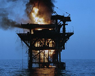 United States Special Operations Command - One of two Iranian oil platforms set ablaze after shelling by American destroyers.