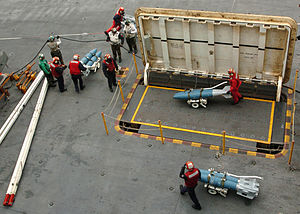 Modern United States Navy carrier air operations - Ordnance is brought to the flight deck from the ship's magazines deep below decks