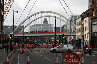 London Overground - The new Overground rail bridge is lowered into place over Shoreditch High Street