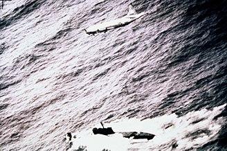 Juliett-class submarine - A P-3C flies over a Juliett-class submarine