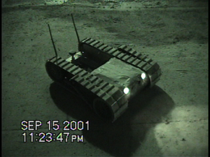IRobot - A PackBot Scout robot shown with its second pair of treads in the horizontal position. This robot is conducting search and rescue at ground zero after the 9/11 terrorist attacks.
