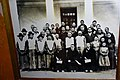 Pala Manor, near Gyantse, Tibet, photograph on display showing the 14th Dalai Lama (front row with glasses in the middle) (1).jpg