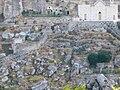 Palagianello - Chiesa e scorcio di gravina.jpg