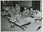 Passengers on the promenade deck of RMS CARONIA (7841759046).jpg