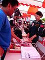 People Buying Memorial Items of ROCA Dragon Team in Booth 20130601.jpg