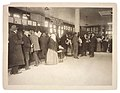 Photograph of Immigrants Buying Railroad Tickets on Ellis Island - NARA - 595656.jpg
