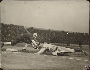 Jiggs Donahue - Donahue tries to tag Frank Chance in a pickoff play during the 1906 World Series, but Chance slides in safely.