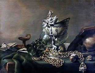 Still life with nautilus cup and musk apple on golden chain