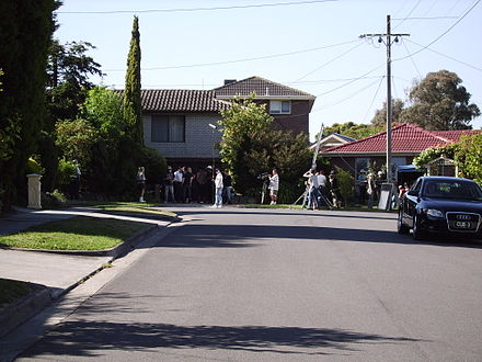 "Pin Oak Court in Vermont South has been called ""Australia's most famous street"", as it is the filming location used to represent the fictional Ramsay Street in Neighbours, Australia's longest running drama television series. Pin Oak Court Filming.jpg"