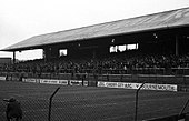 A black and white led photograph of a football stand