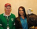 Posing for picture with Bald Eagle. (10595696325).jpg