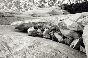 Bivouac shelter - Rock climber Chuck Pratt bivouacking during the first ascent of the Salathé Wall on El Capitan in Yosemite Valley in September 1961.