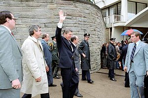 Jerry Parr - US President Ronald Reagan waves just before he is shot outside a Washington hotel on March 30, 1981. From left are Parr, in raincoat, who pushed Reagan into the limousine; press secretary James Brady, who was seriously wounded; Reagan; Michael Deaver, Reagan's aide; unidentified policeman; Washington policeman Thomas K. Delahanty, who was shot; and secret service agent Tim McCarthy, who was shot in the stomach.