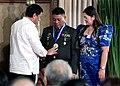 President Rodrigo Duterte awards a medal to Technical Sergeant Danilo Delos Santos Ramos, an outstanding soldier awardee.jpg