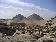 A photograph of two pyramids