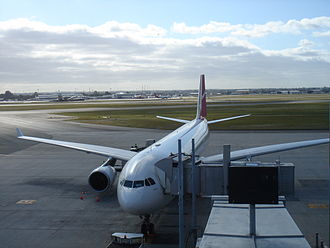 Perth Airport - A Qantas A330-300 docked at Terminal 1. Terminals 3 and 4 are visible in the background.