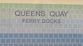 Queens Quay station - Tiles showing station name and Ferry Docks destination