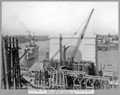 Queensland State Archives 3480 North main pier timber falsework trestles for erection of north anchor arm and completed pier Brisbane 17 June 1937.png