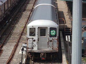 Unused New York City Subway service labels - An R62A car in Corona Yard displays a 12 sign in the apple green color representing the IRT Lexington Avenue Line.