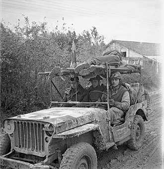 Royal Canadian Army Medical Corps - A jeep ambulance of the Royal Canadian Army Medical Corps (R.C.A.M.C.) bringing in two wounded Canadian soldiers on the Moro River front, south of San Leonardo di Ortona, Italy, December 10, 1943