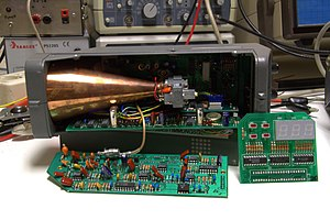 Radar gun - Disassembled radar speed gun.  The copper cone is the microwave horn antenna.  At the right end is the Gunn diode oscillator which generates the microwaves.