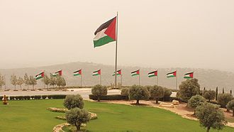 Rawabi - Palestinian flags flying by the Rawabi visitor center in the West Bank.
