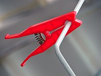 Red clothes peg.jpg