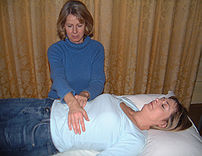 This image depicts a Reiki treatment in progre...