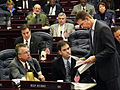 Rep. Marco Rubio reviewing papers in 2004 with Majority Leader Andy Gardiner.jpg