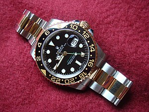 Rolex - Rolex GMT Master II gold and stainless steel (ref. 116713LN)