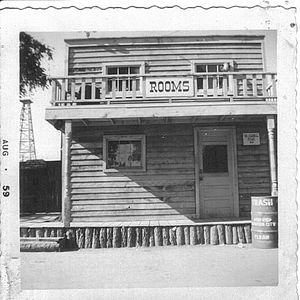 Frontier City - Front of rooming house at original Frontier City location at the Oklahoma State Fair grounds (1959 photograph)
