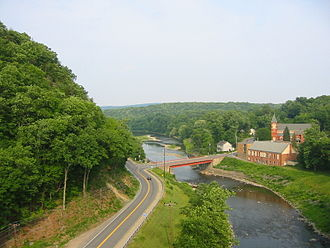 Rosendale, New York - Joppenbergh Mountain (left), Route 213 (center) and the Rondout Creek (right), viewed from the Rosendale trestle overlooking the town