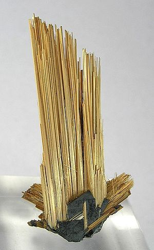 Epitaxy - Rutile epitaxial on hematite nearly 6 cm long.  Bahia, Brazil