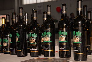 English: Wine bottles at the Public tasting ev...